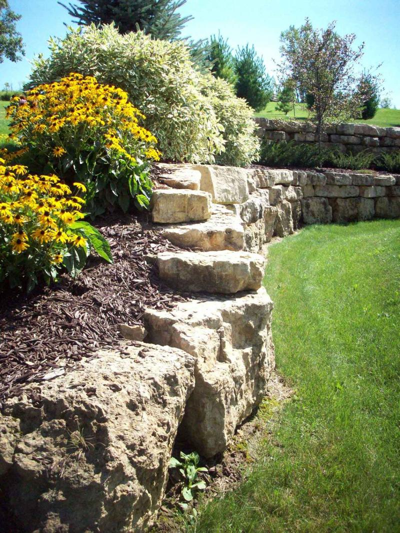 Limestone retaining wall the image kid for Landscape builder